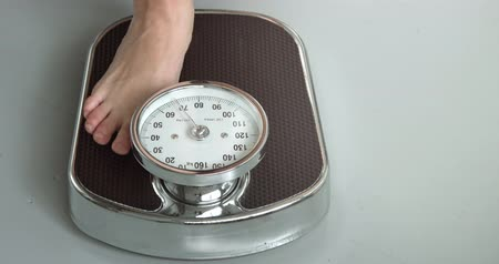 weighing machine : Women weighing machine Stock Footage