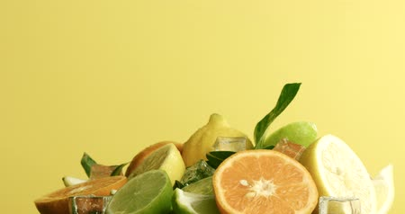 chop up : composition of lemon, orange and lime with an ice cubes turning Stock Footage