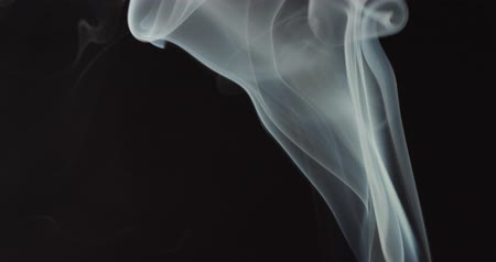 video effects : High contrast video of white smoke moving upwards isolated on black