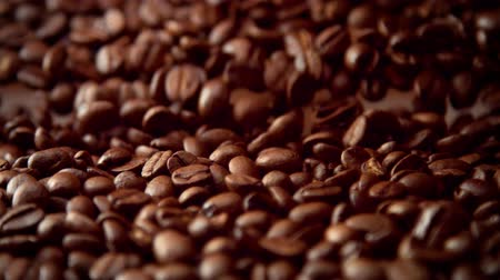 macro : cofee beans closeup falling down slowmotion