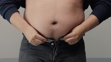 obsessive : overweight man closeup of belly side view. put up shirt and pinch and clap a belly Stock Footage