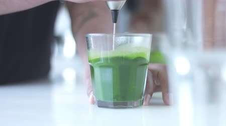 hipster : strong green matcha tee in transparent glass preparation process Stock Footage