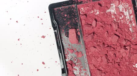 esculpir : head view of makeup blush falling down and broked with pieces of powder get out