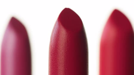 smudged : macro shoot of lipstick Three lipstick moving on white background
