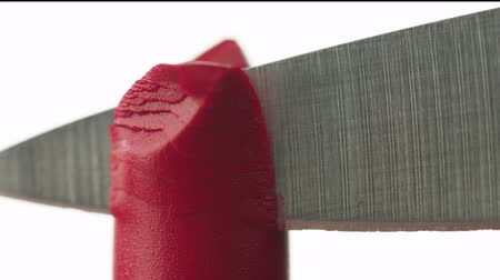 beauty products : knife cut a piece of lipstick Macro cosmetics Stock Footage