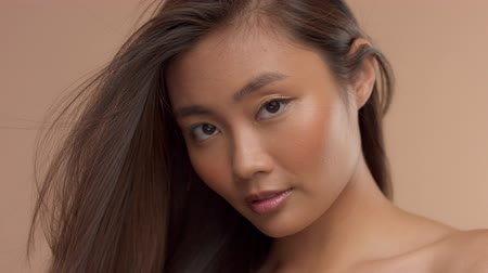multikulturális : closeup portrait of thai asian model with streaming in air straight hair slow motion from 60 fps
