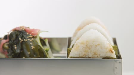 quatro : rolling bento with onigiri and salad
