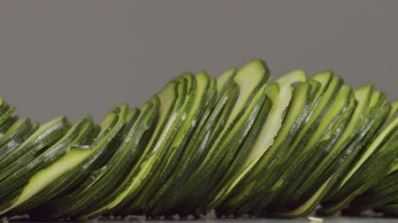 pushed : thinn slices of zucchini pushed from the sides. Closeup macro zucchini Stock Footage