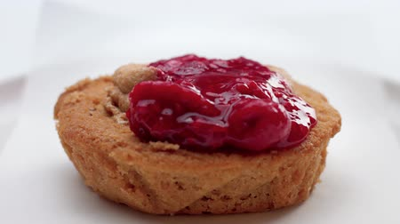 tartlet : small cake with fruit topping pouring on it. Dessert with red berries and fruits