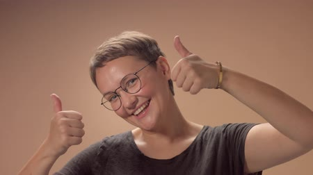 hapiness : Caucasian woman with short haircut smiling wide and lift up her thumbs