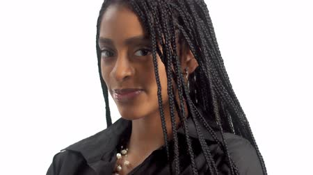 braid hairs : Closeup mixed race woman with dark skintone poss to a camera, shake her hair braids, smiling, touches her hair braids