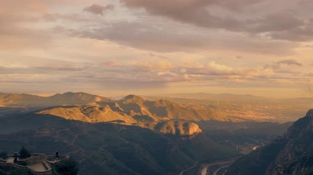 mountains landscape in Spain zone Montserrat at sunset. Cloudy sunset in mountains Stock Footage