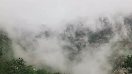 Rainy day in mountains and fast moving clouds texture. Warm wet tropical air with cloud mist
