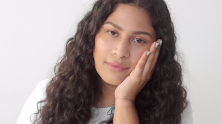 norms : Closeup portrait of young mixed race plus size woman without makeup smiling to the camera