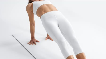 levantado : Senior woman in white space practice yoga lifted up her body in a bridge pose and hold it on top position