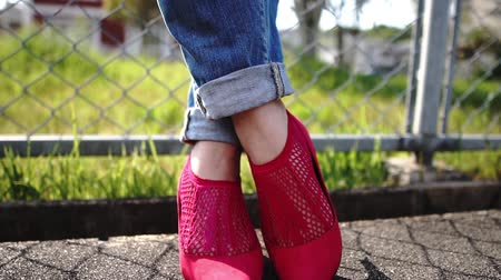 denim : woman in red shoes