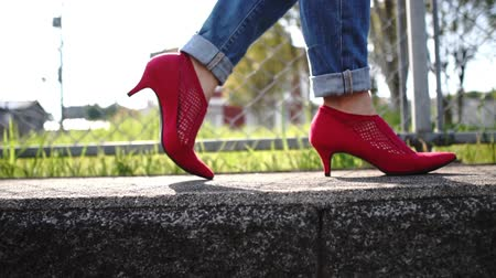 woman walking with red shoes