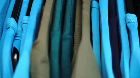 Many lined blue t-shirt Stock mozgókép