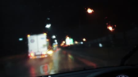 car driving a rainy night road