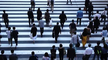 People across the crosswalk