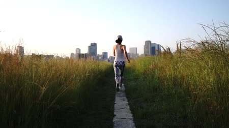 A woman who runs toward the city