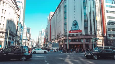 ginza : Tokyo, Japan - Jan 13, 2019: 4K UHD Motion timelapse of Ginza 4-Chome crossing, crowded people and transportation across junction. Ginza is Tokyo famous shopping area where car traffic close on Sunday Stock Footage