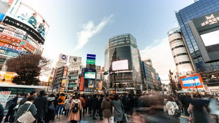 Tokyo, Japan - Jan 10, 2019: 4K UHD time-lapse of Shibuya crossing, crowded people and car traffic transport across intersection. Tokyo tourist attraction, Japan tourism, or Asian city life concept