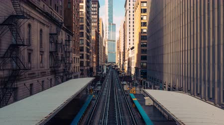 Chicago, United States - Mar 15, 2019: 4K UHD Time-lapse of trains in railway station between building in downtown Chicago. Urban public transportation, USA landmark, or American city life concept Stock Footage