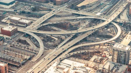 indaffarato : 4K UHD top view time-lapse of car traffic on highway road intersection in Chicago, USA. Transportation or city life concept Filmati Stock