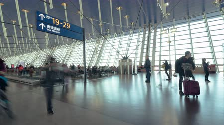 4K UHD Time-lapse of unidentified people walking in airport transit terminal. Air transportation, international tourism, travel abroad, or commuter lifestyle concept Stock Footage