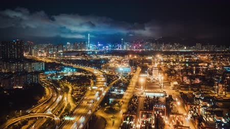 container terminal : 4K hyperlapse time-lapse of Hong Kong port industrial district, highway traffic, and the city Symphony of light show on buildings. Asia developing country, logistic industry, or Asian tourism concept