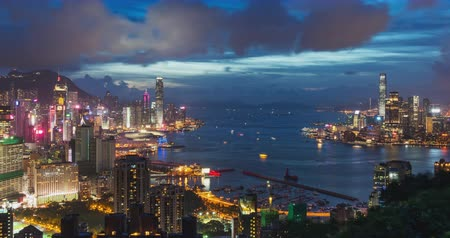 ferry terminal : 4K DCI day to night time-lapse of landscape or cityscape of Hong Kong island, Victoria harbour, and Kowloon city, view from Red incense burner summit. Asia travel destination concept. Panning camera