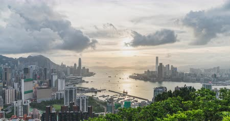ferry terminal : 4K DCI day to night time-lapse of landscape or cityscape of Hong Kong island, Victoria harbour, and Kowloon city, view from Red incense burner summit. Asia travel destination or Asian tourism concept