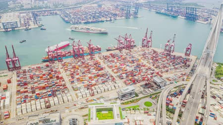 4K UHD hyperlapse timelapse of Hong Kong port industrial district with cargo container ship, crane, and car traffic. Logistic industry or freight transportation business concept, drone aerial top view