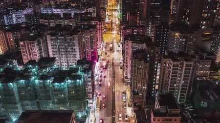 4K UHD Hyperlapse time-lapse of car traffic on road and people walking at night in Hong Kong downtown district, drone aerial dolly top view. Commuter, Asia city life, or public transportation concept