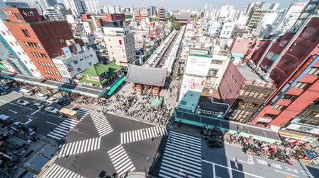 senso ji : Tokyo, Japan - Nov 4, 2019: time-lapse of people walking, car transportation in Asakusa, Senso-ji temple, Kaminarimon and Nakamise road. Tokyo tourism landmark, Japan travel, or Japanese city life