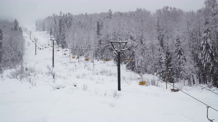 snowboard : Ski Lift in the Mountains Under Snowfall