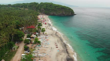 девственница : BALI, INDONESIA - DECEMBER 29, 2018: Aerial view flying over the tropical virgin beach, Bali island. Asia.