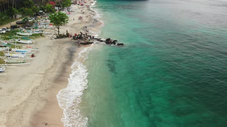 virgem : BALI, INDONESIA - DECEMBER 29, 2018: Aerial view flying over the tropical virgin beach, Bali island. Asia.