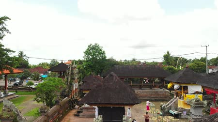 local de culto : Flying with drone over balinese traditional temple. 4K aerial view footage, no edit. Stock Footage