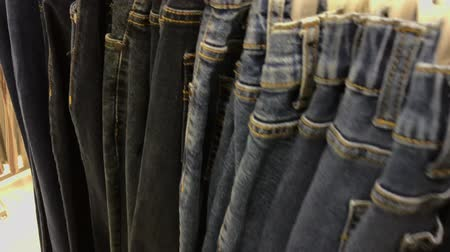 çivit : Close up of many jeans in the store. 4K footage in the shopping mall.