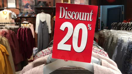 százalék : Discount sign plate in the store. Shopping mall. 4K footage. Retail, sale, market.