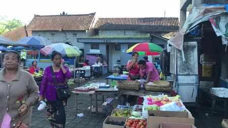 BALI, INDONESIA - FEBRUARY 21, 2019: Balinese traditional food market at morning time. People on market.