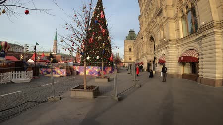 MOSCOW, RUSSIA - NOVEMBER 24, 2019: Moscow Kremlin and Christmas decorations on Red square, hyperlapse. New Year trees in Russia.