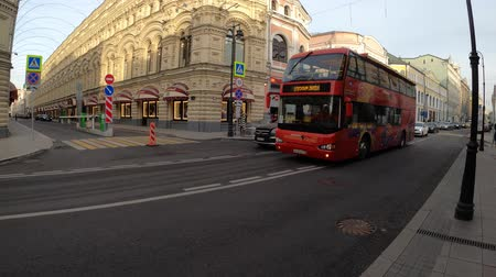 ленивый : MOSCOW, RUSSIA - NOVEMBER 24, 2019: Red city sightseeing tourist bus on the street near to Red Square.