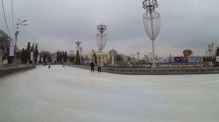 MOSCOW, RUSSIA - NOVEMBER 27, 2019: People riding on the big city ice skating rink at VDNKh.