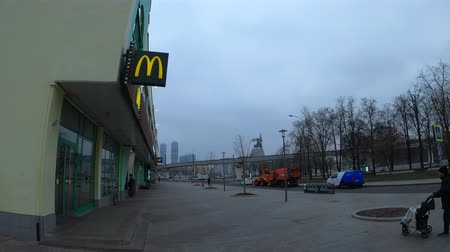MOSCOW, RUSSIA - NOVEMBER 27, 2019: Mcdonalds store at cloudy weather. Time lapse. Stock mozgókép