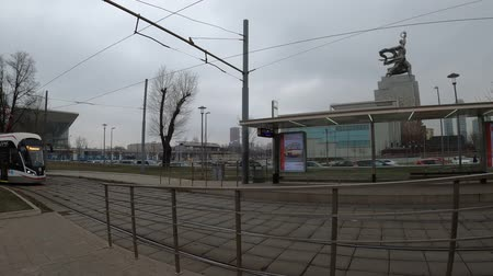 муниципальный : MOSCOW, RUSSIA - NOVEMBER 27, 2019: Tram rides by rails during cloudy day. VDNKh station.