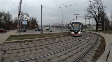 sáně : MOSCOW, RUSSIA - NOVEMBER 27, 2019: Tram rides by rails during cloudy day. VDNKh station.