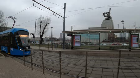 MOSCOW, RUSSIA - NOVEMBER 27, 2019: Tram rides by rails during cloudy day. VDNKh station.